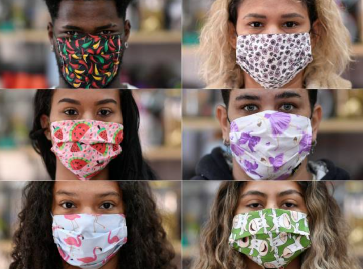 疫情期間各人帶上特色的口罩。(圖:Getty Images)