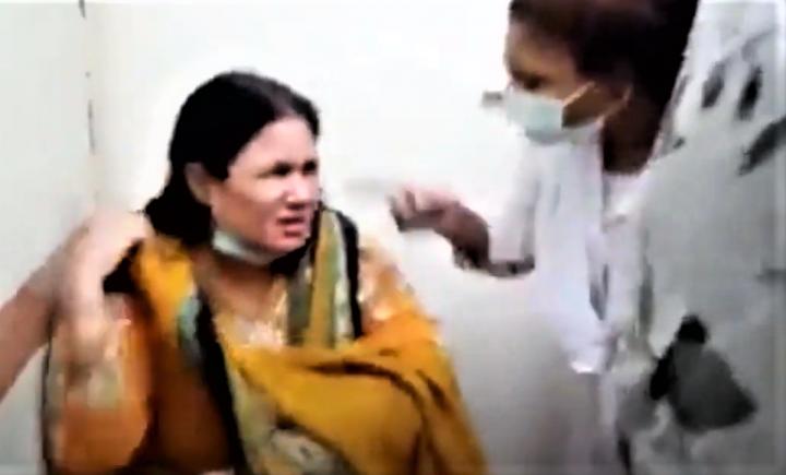 基督教護士吉爾[左]被關在房間遭指罵和暴力。(圖:視頻擷圖)